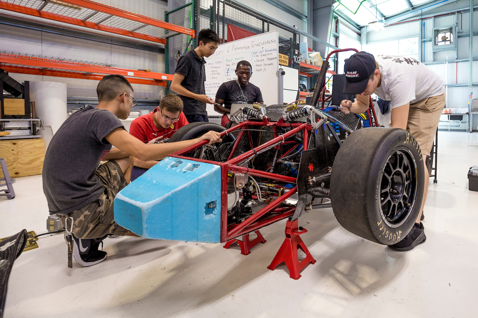 students working on a race car project