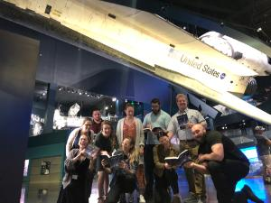 Class of Students Studying under space shuttle Atlantis